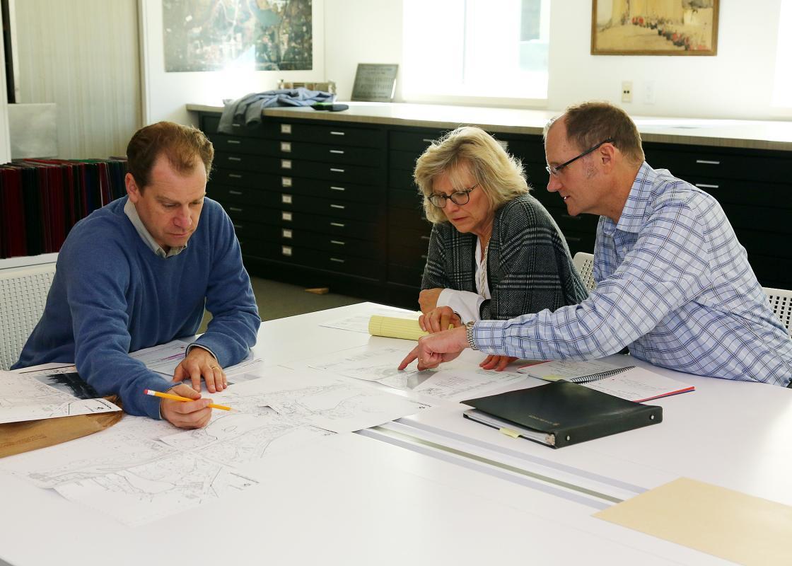 Preservation Landscape Architect Gregory W. De Vries reviewing the Quinn Evans Historic Landscape Study