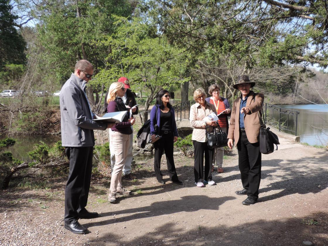 Dr. Kendall Brown of California State University leads a tour of the Cranbrook Japanese Garden for the Center staff and Subcommittee Members