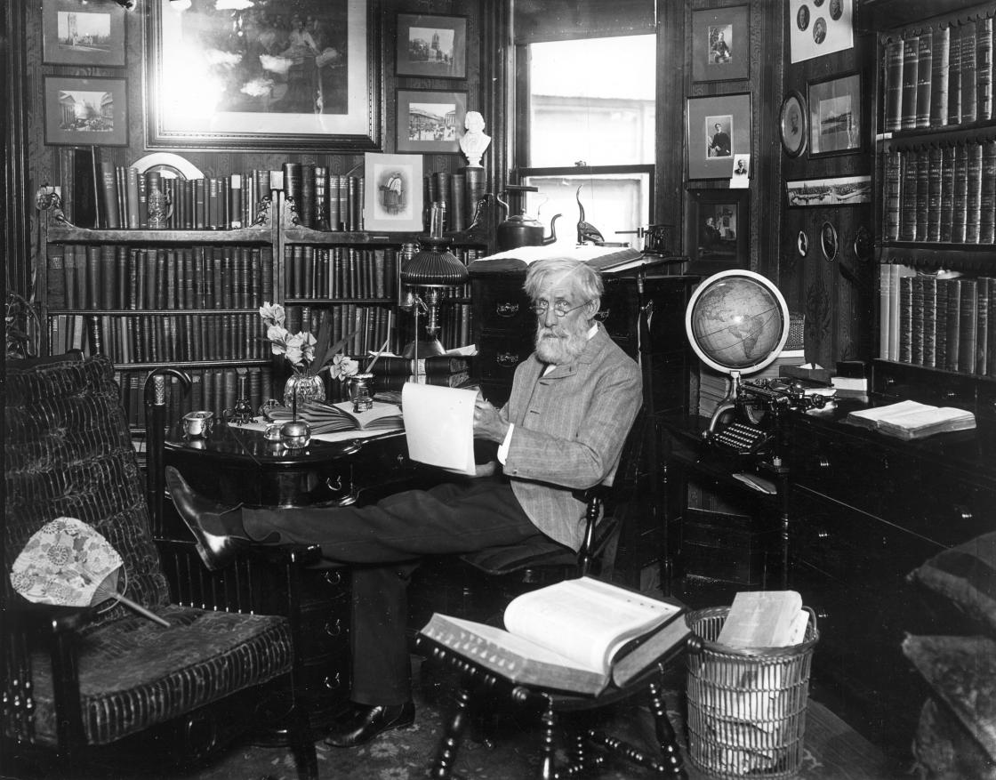 Henry Wood Booth, circa 1904. Photograph Collection of Cranbrook Archives (E222). Henry Booth is seated in his study in his home on Trumbull Avenue in Detroit, where Clara Booth and he lived before moving to the Cottage at Cranbrook.