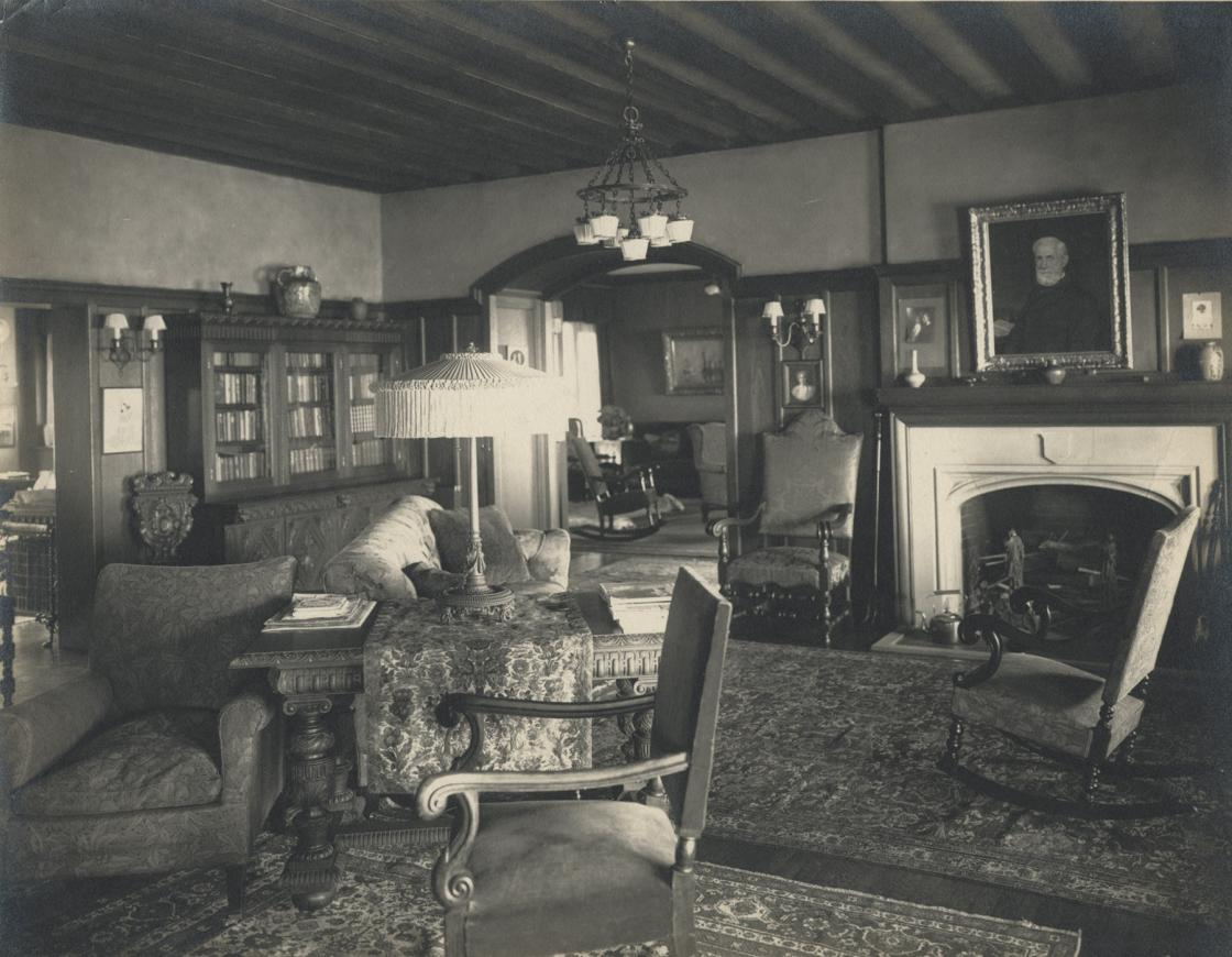 Cranbrook House Reception Hall, circa 1916. Photography Collection of Cranbrook Archives (E452). The portrait of Henry Booth by Robert J. Wickenden is hanging over the fireplace.