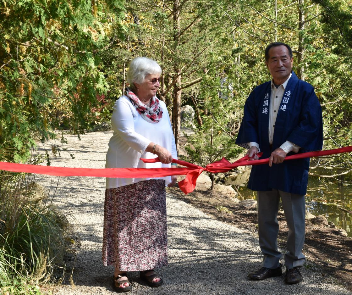 Lily Pond Cascade ribbon cutting ceremony with Master gardener Hiromu Terashita and Center Patron Jeanne Graham