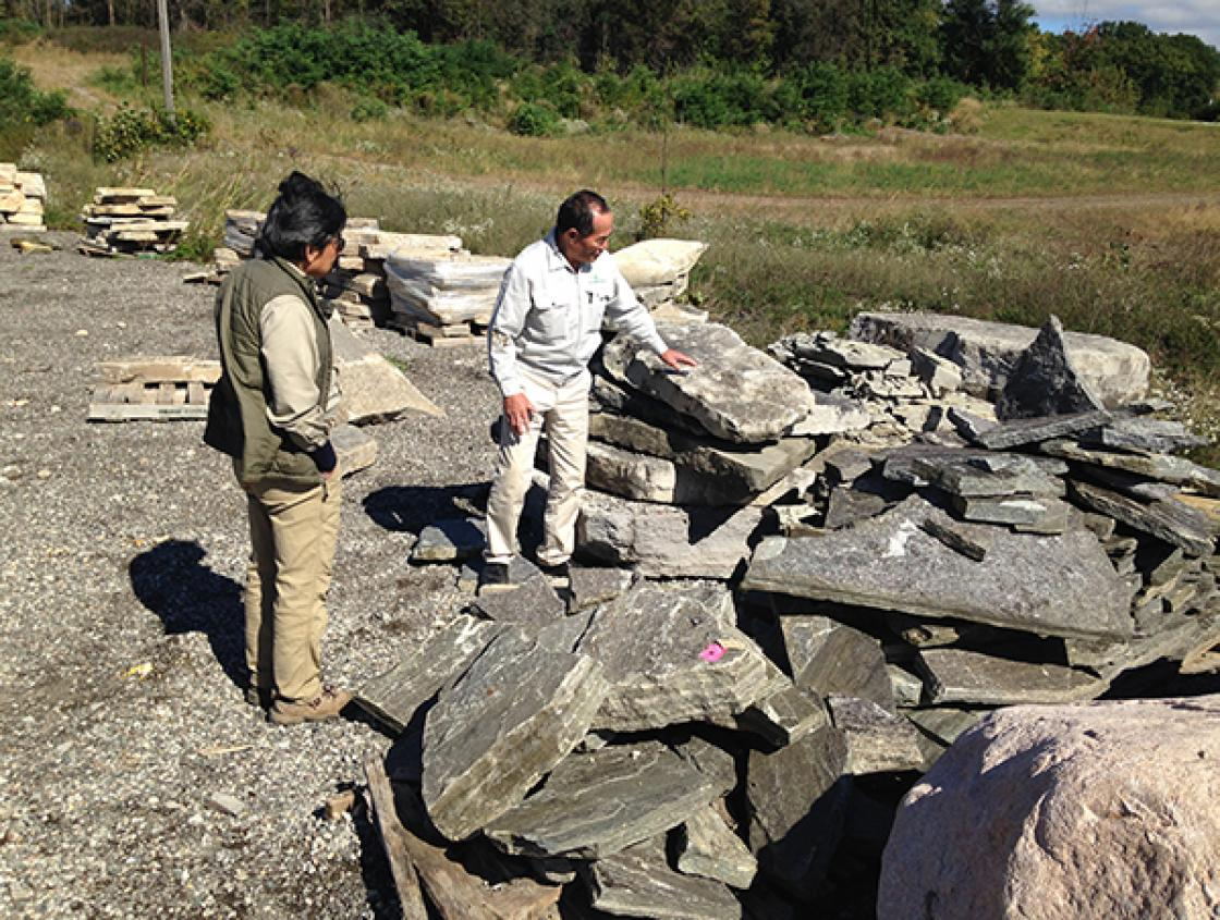 Sadafumi Uchiyama (left) and Hiromu Terashita Select Stone Slabs for Lily Pond Cascade Bridges at Orion Stone Wholesale in Orion, Michigan, October 4, 2018. Photography by Gregory Wittkopp.